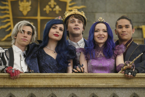 """DESCENDANTS 3 - This highly anticipated third installment in the global hit Disney Channel Original Movie franchise continues the contemporary saga of good versus evil as the teenage daughters and sons of Disney's most infamous villains-Mal, Evie, Carlos and Jay (also known as the villain kids or VKs)-return to the Isle of the Lost to recruit a new batch of villainous offspring to join them at Auradon Prep. When a barrier breach jeopardizes the safety of Auradon during their departure off the Isle, Mal resolves to permanently close the barrier, fearing that nemeses Uma and Hades will wreak vengeance on the kingdom. Despite her decision, an unfathomable dark force threatens the people of Auradon and it's up to Mal and the VKs to save everyone in their most epic battle yet. """"Descendants 3"""" is set to premiere on FRIDAY, AUG. 2 (8:00-10:00 p.m. EDT), on Disney Channel and DisneyNOW. (Disney Channel/David Bukach) CAMERON BOYCE, SOFIA CARSON, MITCHELL HOPE, DOVE CAMERON, BOOBOO STEWART"""
