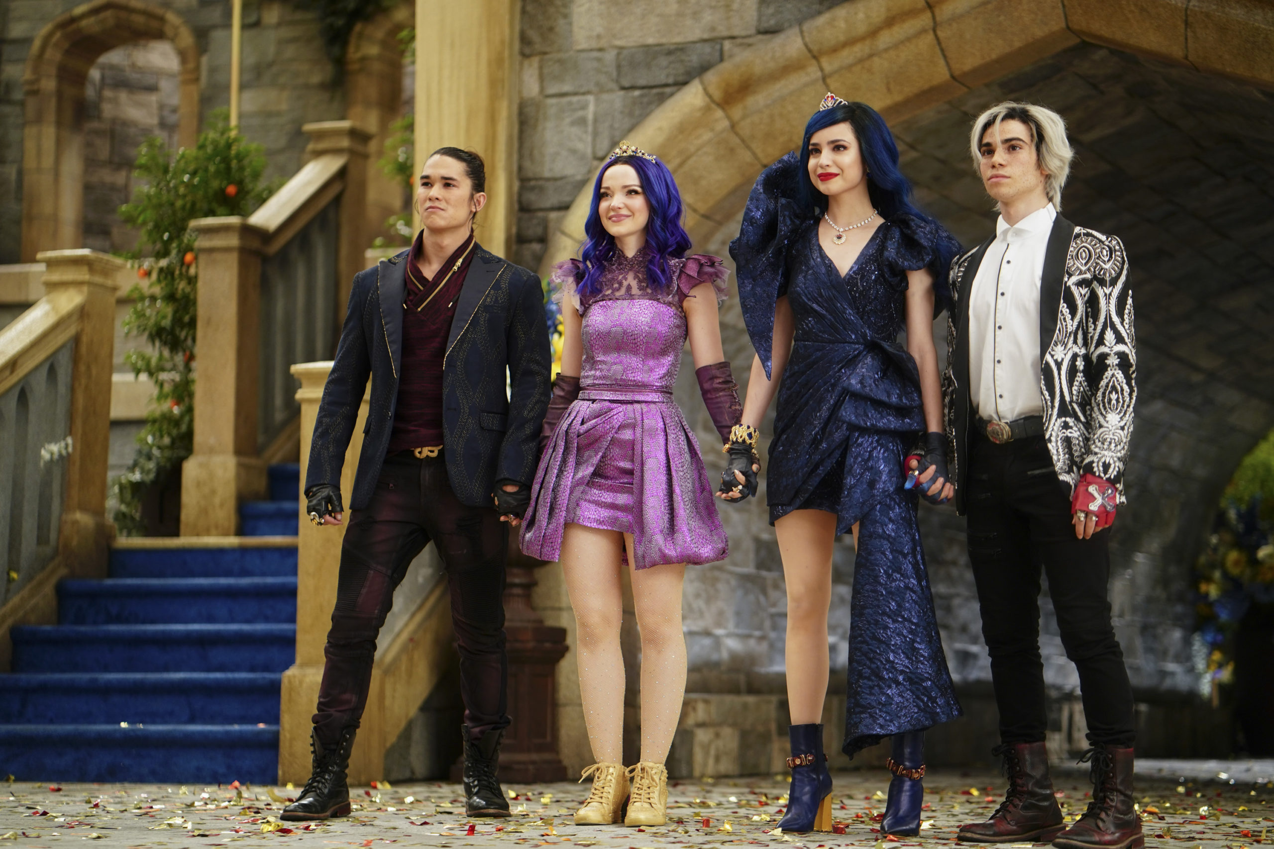 """DESCENDANTS 3 - This highly anticipated third installment in the global hit Disney Channel Original Movie franchise continues the contemporary saga of good versus evil as the teenage daughters and sons of Disney's most infamous villains-Mal, Evie, Carlos and Jay (also known as the villain kids or VKs)-return to the Isle of the Lost to recruit a new batch of villainous offspring to join them at Auradon Prep. When a barrier breach jeopardizes the safety of Auradon during their departure off the Isle, Mal resolves to permanently close the barrier, fearing that nemeses Uma and Hades will wreak vengeance on the kingdom. Despite her decision, an unfathomable dark force threatens the people of Auradon and it's up to Mal and the VKs to save everyone in their most epic battle yet. """"Descendants 3"""" is set to premiere on FRIDAY, AUG. 2 (8:00-10:00 p.m. EDT), on Disney Channel and DisneyNOW. (Disney Channel/David Bukach) BOOBOO STEWART, DOVE CAMERON, SOFIA CARSON, CAMERON BOYCE"""